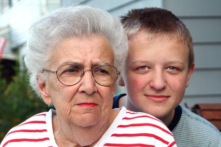 Worried grandmother with smiling grandson.