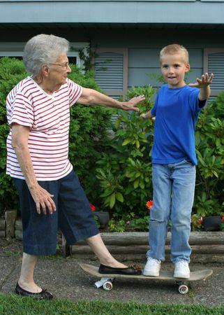 Senior and boy on a skateboard.