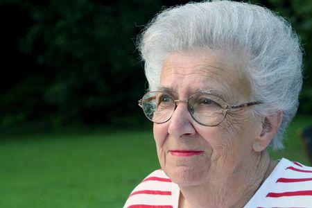 bifocals: Portriat of senior citizen woman at park.