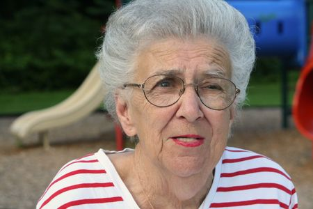 contradict: Portrait of senior citizen woman at playground.