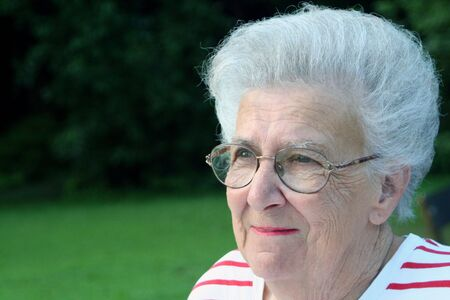 peppy: Portrait of smiling senior citizen woman. Stock Photo