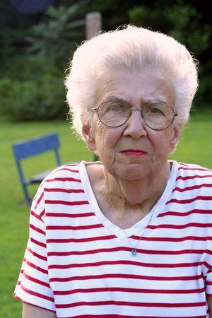 bifocals: Portrait of serious senior citizen woman at a park.