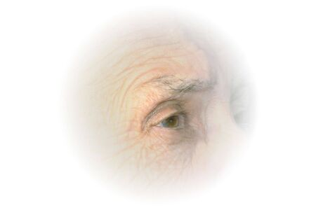 Vignette of senior citizen womans right eye in profile.