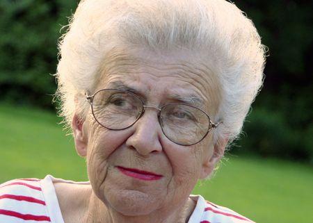Portrait of serious senior citizen woman.