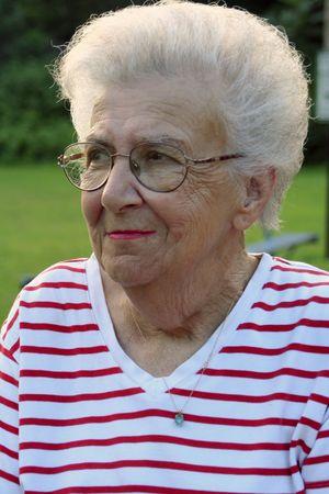 bifocals: Portrait of senior citizen woman at playground.