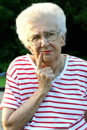 reminisce: Senior citizen woman in questioning pose. Stock Photo