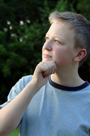 deduce: Teenage boy in thinking pose.
