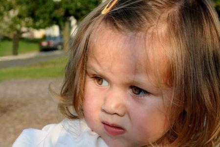 Closeup of a questioning little girl's face.
