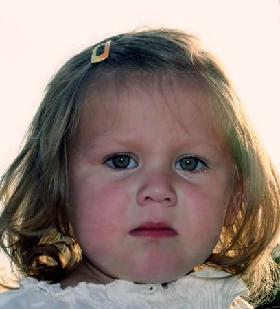ambivalent: Emotional face of a little girl.