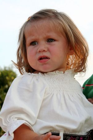Little girl with doubtful expression. Banco de Imagens