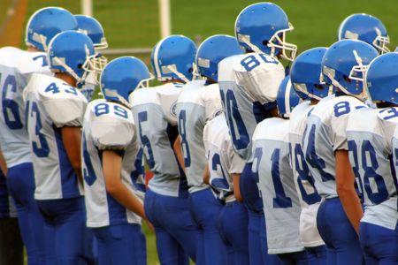 High school football team on field.