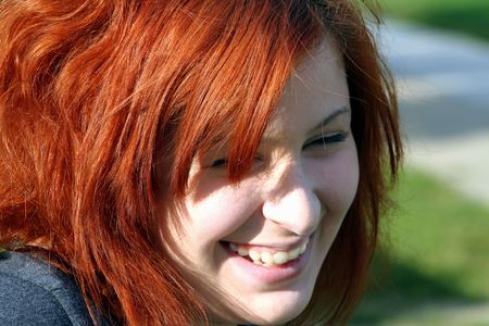 likable: Portrait of laughing teenage girl.