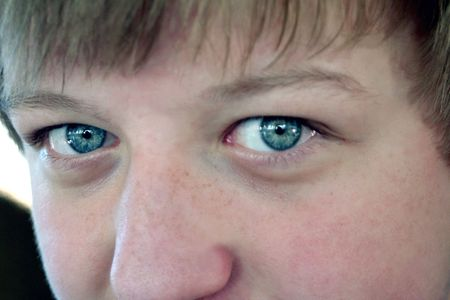 Closeup of the blue eyes of a young teenage boy. Stock Photo