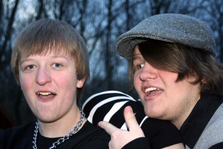 ornery: Closeup of two joking teenage brothers, taken outdoors.