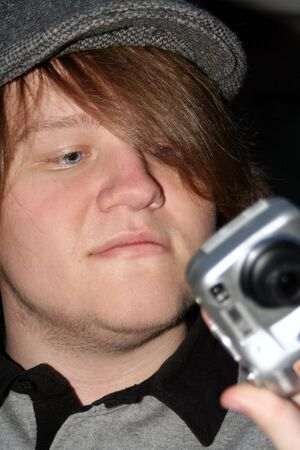pix: Teen boy checking picture he took on a point and shoot digital camera.