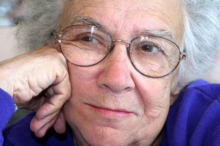 Closeup of a thoughtful senior citizen woman.