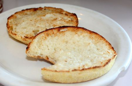 Toasted English muffin on a white plate. Stock Photo