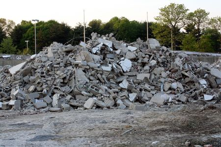 raze: Pile of broken concrete and cinder blocks from a building demolition. Stock Photo