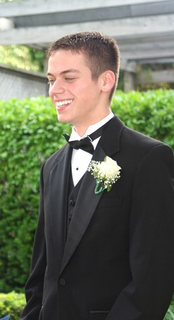 Smiling Prom Teen Boy in Profile  Imagens