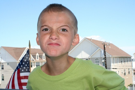 animosity: Angry Boy Outdoors Stock Photo