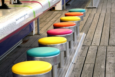 ARCADE GAMES: Colorful Game Stools Stock Photo