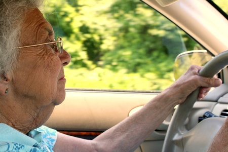 safe driving: Senior Citizen Woman Driving in Profile