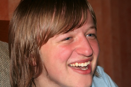 agreeable: Laughing Teen Boy Closeup