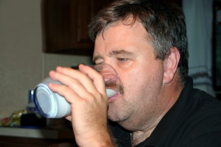 Middle-Aged Man Drinking Milk Stock Photo - 13398831