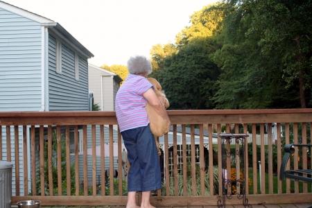 Senior Woman Holding Puppy Horizontal photo