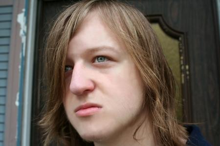 Depressed Teen In Doorway