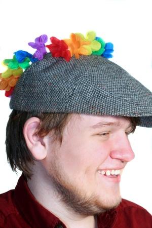 newsboy cap: Smiling Teen Boy Wearing Flat Cap And Flowers