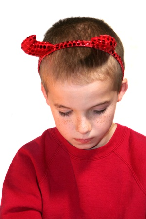 bowed head: Little Devil Boy With Bowed Head Stock Photo