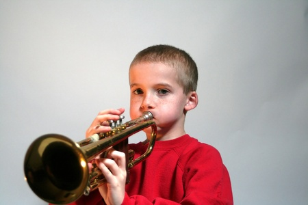 Puffy Cheeked Boy Playing Trumpet photo