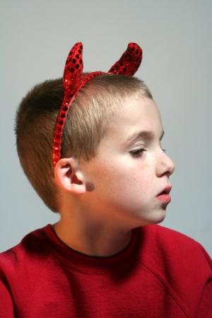 Little Devil Boy In Profile Stock Photo - 16882688