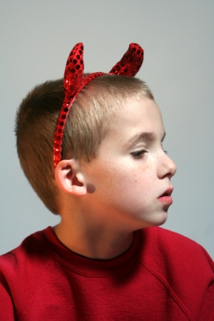 Little Devil Boy In Profile Stock Photo - 16882688
