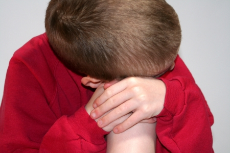 Sad Anonymous Boy Closeup Leaning Against Knee Stock Photo - 16882689