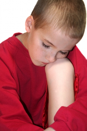 Sad Boy Closeup Against Knee Looking Down Stock Photo - 16882685