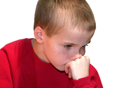 conflicted: Thinking Boy Looking Down Stock Photo