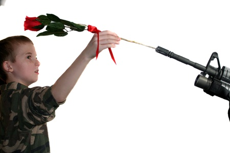 Child Placing Rose In Rifle 2 Stock Photo - 16882694