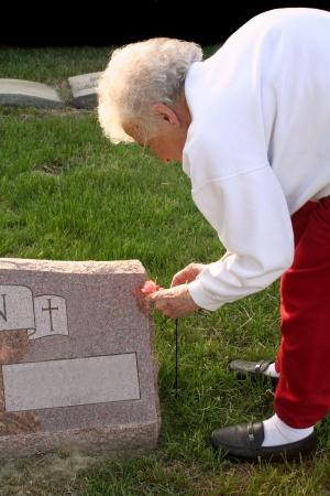 Senior Woman Visiting Grave Stock Photo