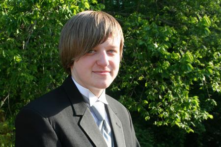 Smiling Teen Boy In Black Tuxedo Horizontal photo