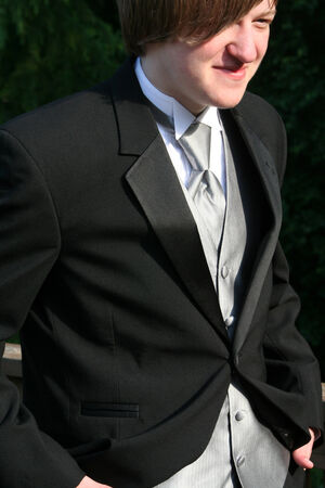 Smiling Teen With Hands In Pockets Of Tuxedo