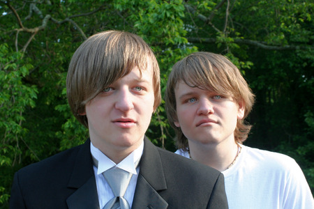 Serious Brothers In Tux And T-Shirt photo