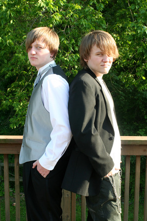 Serious Tuxedoed and Casual Teens photo
