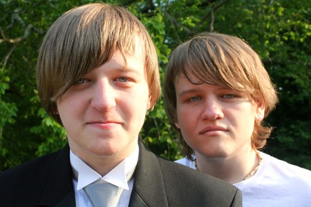 Teen Brothers In Tux And T-Shirt Imagens