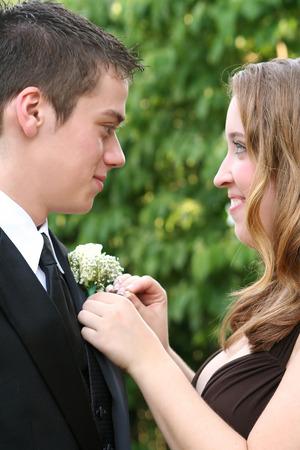 teenage male: Prom Girl Fixing Dates Flower 2 Stock Photo