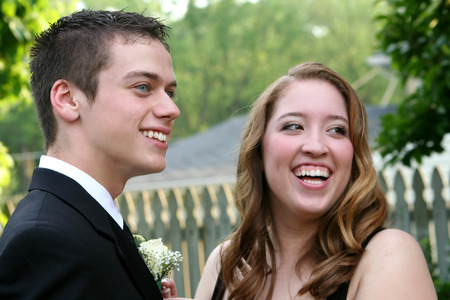 Laughing Prom Couple Showing Boutonniere