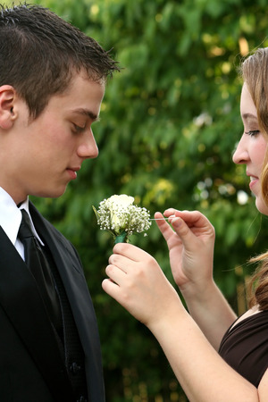 fashion  babies's wear: Prom Couple Preparing Boutonniere