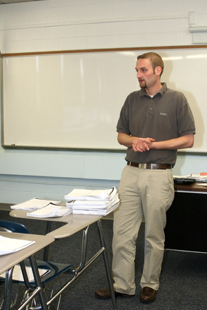instructing: Teacher Instructing In Classroom Stock Photo