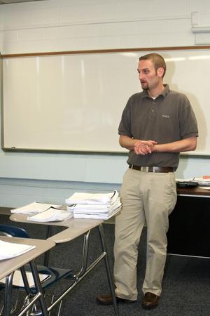 instructing: Teacher Instructing In Classroom Stock Photo